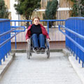 woman-in-wheelchair-ramp-at-local-authority